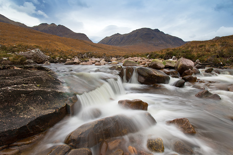 Waterfall in Coire Mhic Nobaill with Beinn Dearg and Sgurr Mor in background, Torridon, Wester Ross, Scotland