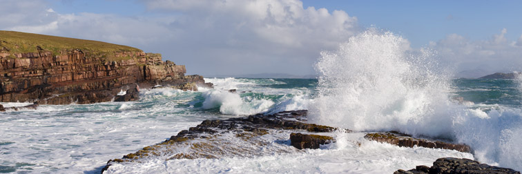 Waves crashing over rocky coastline near Point of Stoer, Assynt, North west Scotland, October
