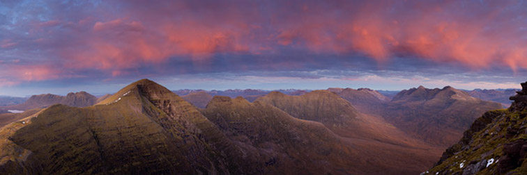 Torridon mountains at dusk. View from Tom na Gruagaich (Beinn Alligin) towards Sgurr Mhor (left), Beinn Dearg (centre) and Liathach (right) taken just after sunset with light reflecting down from clouds. northern Scotland.