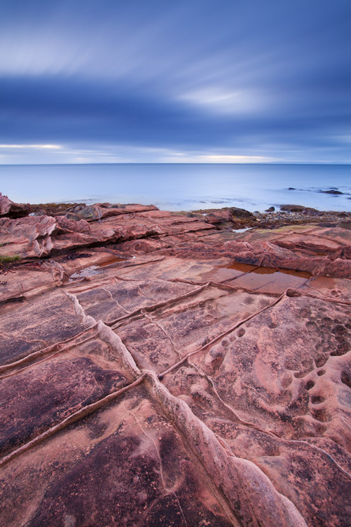 Sandstone rocks and sea view, Isle fo Arran, Scotland, UK