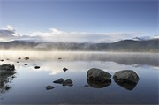Loch Morlich and Cairngorm mountains on misty morning. Cairngorms National Park. Scotland. May 2007.